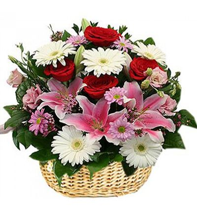 gerbera and chrysanthemum in basket Spring flowers in the buscket